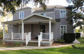 Built front porch and installed new vinyl siding